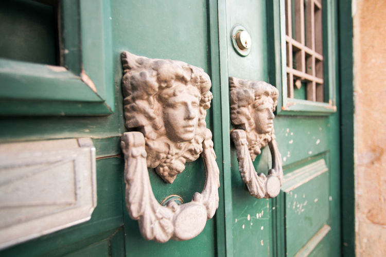 Close-up of horse sculpture by door