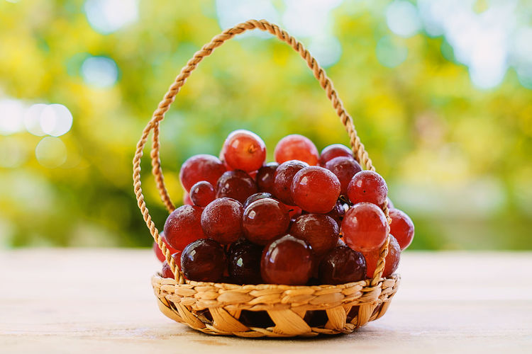 Close-Up Of Grapes In Basket On Table