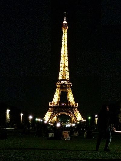 Tower Travel Destinations Tourism Tall - High Architecture Built Structure Travel History Monument Eiffel Tower Paris France Eiffeltower Illuminated Night Architectural Feature City Large Group Of People City Life Outdoors Building Exterior Sculpture Clear Sky Sky