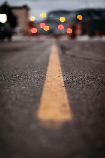 Low angle view of yellow line on paved road.