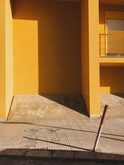 The Architect - 2017 EyeEm Awards Architecture Built Structure No People Day Yellow Sicilia Sicily Warm Colors Contrast And Lights Shadows & Lights Light And Shadow Shadow Empty Architectural Yellow Color Cefalu