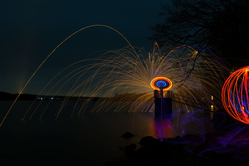 Nightphotography Orb Arts Culture And Entertainment Blurred Motion Clear Sky Illuminated Light Painting Lightpainting Long Exposure Motion Multi Colored Night Outdoors Speed Spinning Steelwool Steelwoolphotography Water Wire Wool