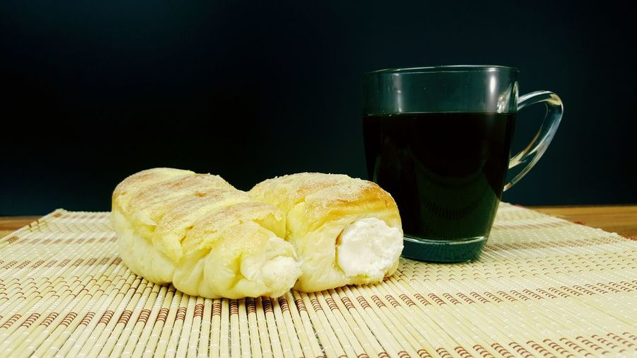 Cofee cup cream bread bamboo table
