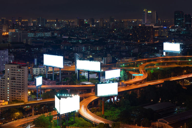 Blank sign over high way in Bangkok,Thailand Blank Sign Poster Advertisement Message Template Cityscape Highway Traffic Street Urban Road Lights Commercial Sign Showing Road Intersection Urban Skyline City Life Bangkok Thailand