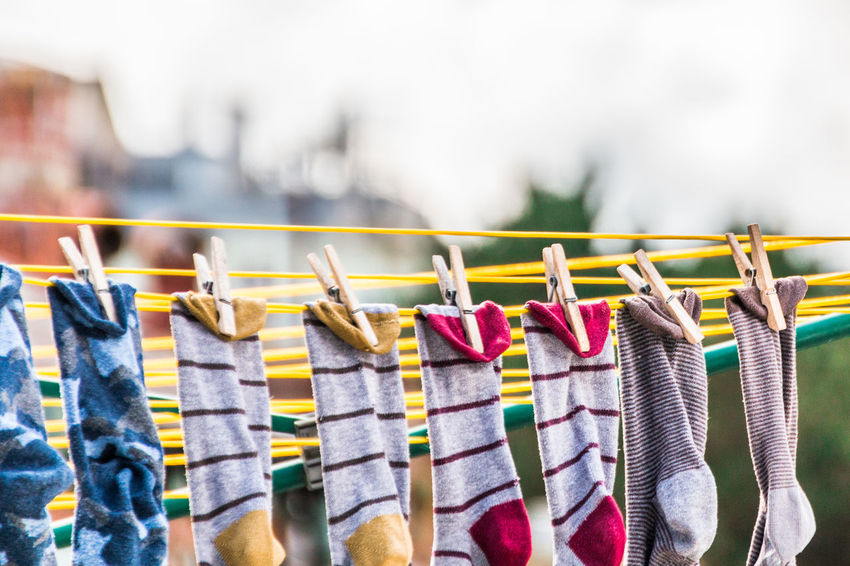 Hanging Multi Colored Clothing In A Row Variation Focus On Foreground Day Clothespin No People Choice Large Group Of Objects Laundry Clothesline Side By Side Textile Selective Focus Group Of Objects Outdoors Order Socks Drying Clothes