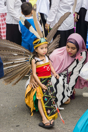 Dayak tribe clothing at kindergarten carnival Adult Carnival Crowds And Details Child Childhood Day Dayak Costume EyeEmNewHere Full Length Girls Kindergarten Looking At Camera Mother Mother And Daughter Outdoors People Portrait Standing Street Photography Traditional Clothing Carnival Crowds And Details Women Around The World The Street Photographer - 2017 EyeEm Awards