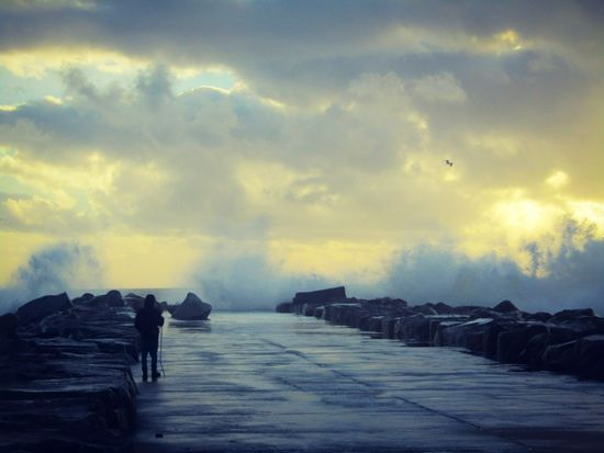 Brave man against the sea Man And Sea Winter Espinho Beach Beauty In Nature Sunset Portugal Sea Nature Photographer