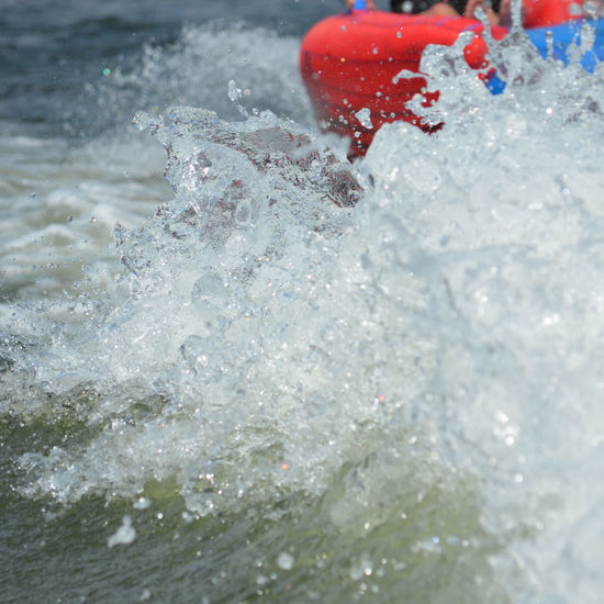 Full frame wake water splash in front of a red inflatable tube Beauty In Nature Boat Close-up Day Day On The Lake Family Fun Full Frame Lake Lake Life Lifestyles Minimalist Nature No People Outdoors Recreation  Red Splashing Sunny Tubing Wake - Water Water Water Sports Waves Sommergefühle