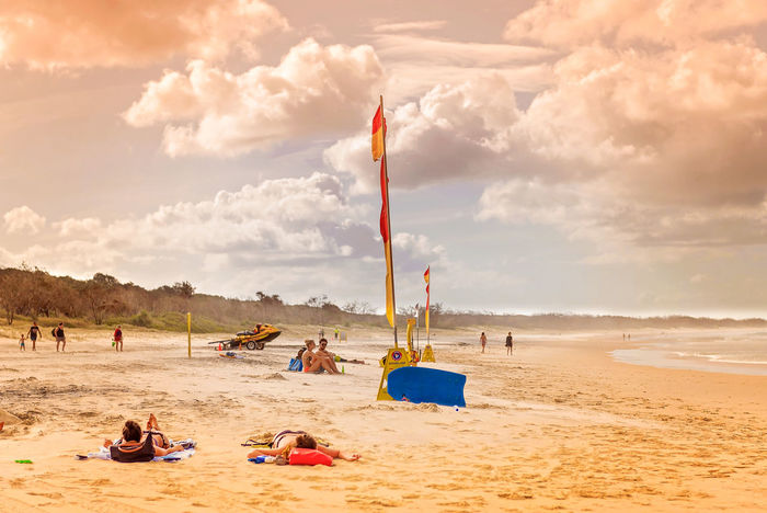 Swim between the Flags Beach Cloud - Sky Enjoyment Flags Large Group Of People Leisure Activity Lifestyles Sand Scenics Sea Shore Sky Sunshine Surf Life Saving Tourism Tourist Tranquil Scene Vacations