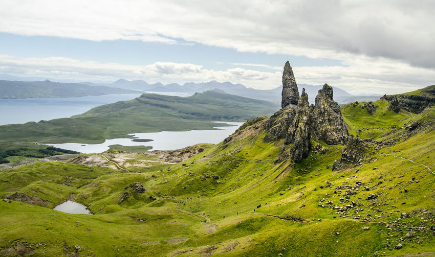 One of my favorite images I've ever made. I only can recommend to visit Scotland. Amazing, isn't it? Have a nice weekend! Asian Culture Green Color Hiking Nature Rock Formation Scotland Scotland 💕 Skye Tourist Attraction  Tranquility Travel Wanderlust Whisky Tasting Beauty In Nature Boulder Cloud - Sky Day Grass Green Color Isle Of Skye Landscape Mountain Nature No People Oldmanofstorr Outdoors Physical Geography Scenics Sky Storr Thestorr Tourism Tranquil Scene Tranquility Water An Eye For Travel