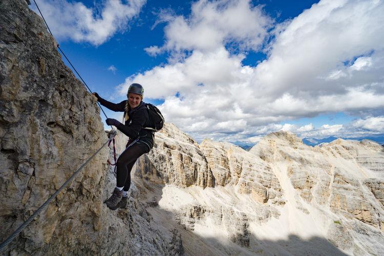 Smiling woman rock climbing