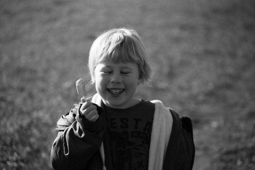 Boy Smiling Sun In The Background Black And White Monochrome Boy Sun Smile Candid Eyes Shut Child Son