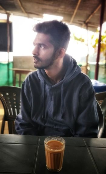 Mornings with this fellow! Tea Mornings EyeEm Selects Loveforphotography Handsome EyeEmNewHere Candid Candidphotography Dreamer Morningtea Men Drink Drinking Sitting