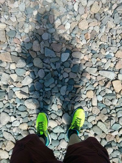 Shoes on rocks Asic Fluo  Yellow Bretagne Beach Galets