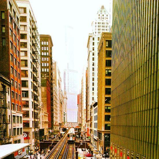 Downtown Chicago CTA Loop green line train, trump tower high rises, red brick, target, tracks, vivid perspective