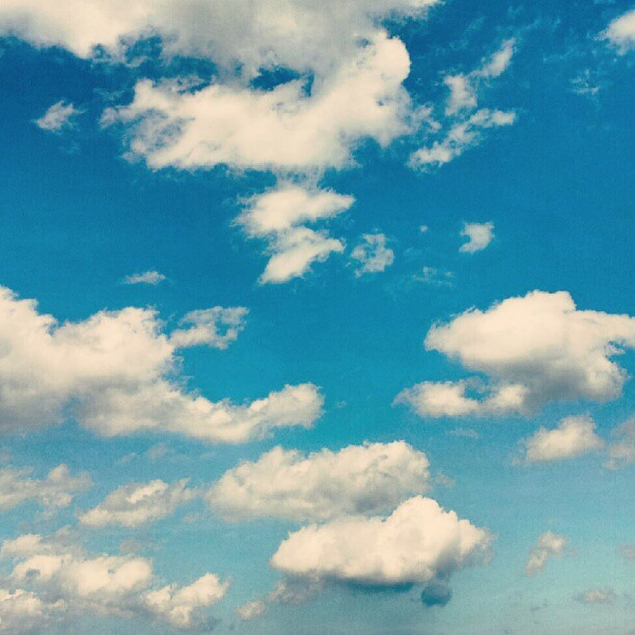 cloud - sky, sky, nature, fluffy, beauty in nature, cloudscape, backgrounds, blue, sky only, softness, heaven, tranquility, scenics, full frame, no people, day, low angle view, outdoors