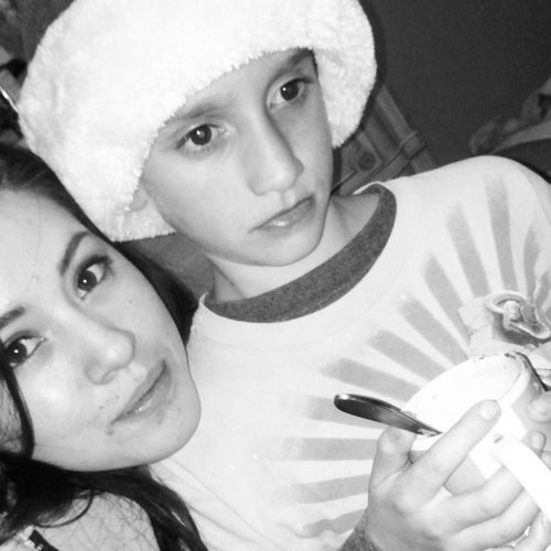 Haha he didn't wanna look at the camera. Lol MyNephew Blackandwhitepic WeHaveACloseBond Santahat