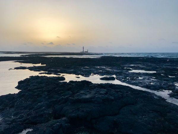 Sea Water Sky Scenics - Nature Beauty In Nature Horizon Horizon Over Water Land Beach Sunset Tranquility Rock Tranquil Scene Nature Idyllic Non-urban Scene Rock - Object Solid Silhouette Outdoors