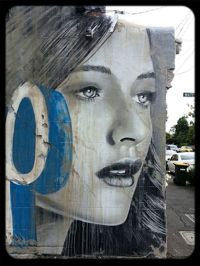 Rone Streetart in Collingwood of a beautiful face on the side of a House