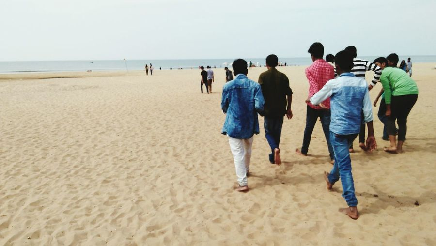 EyeEm Selects Beach time Beach Vacations Togetherness Sand Sea Sand Dune Horizon Over Water People Travel Destinations Walking Landscape Summer Friends Gokarna Nature Lifestyles Day Adult Full Length Men Outdoors Water Crafted Beauty EyeEmNewHere Be. Ready.