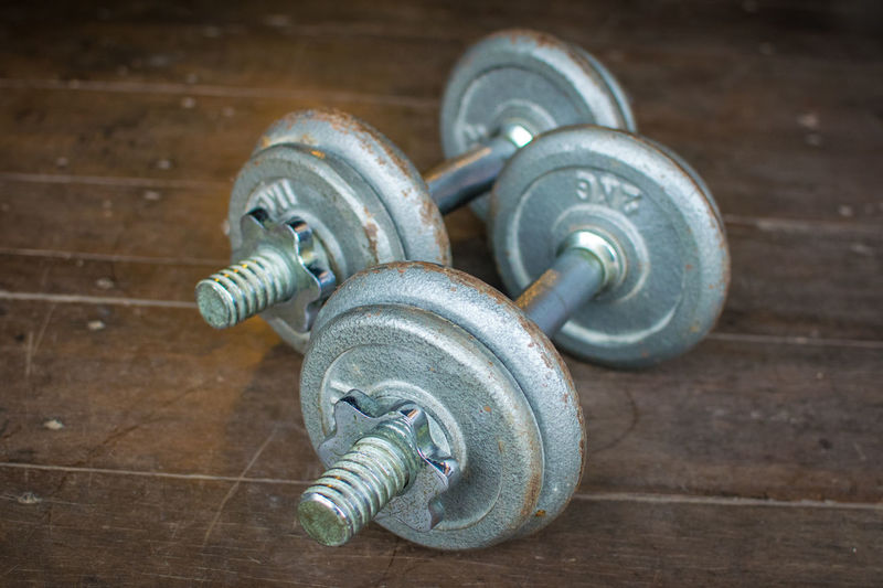Metal dumbell on wood floor background Body & Fitness BodyBuilder Bodybuilding Exercise Iron Wood Aluminium Backdrop Background Close-up Color Colour Day Dumbbell Fit Fitness Floor Focus On Foreground Gym Health Healthy In Door Indoors  Kilo Metal No People Old Wood Sport Strength Wood - Material