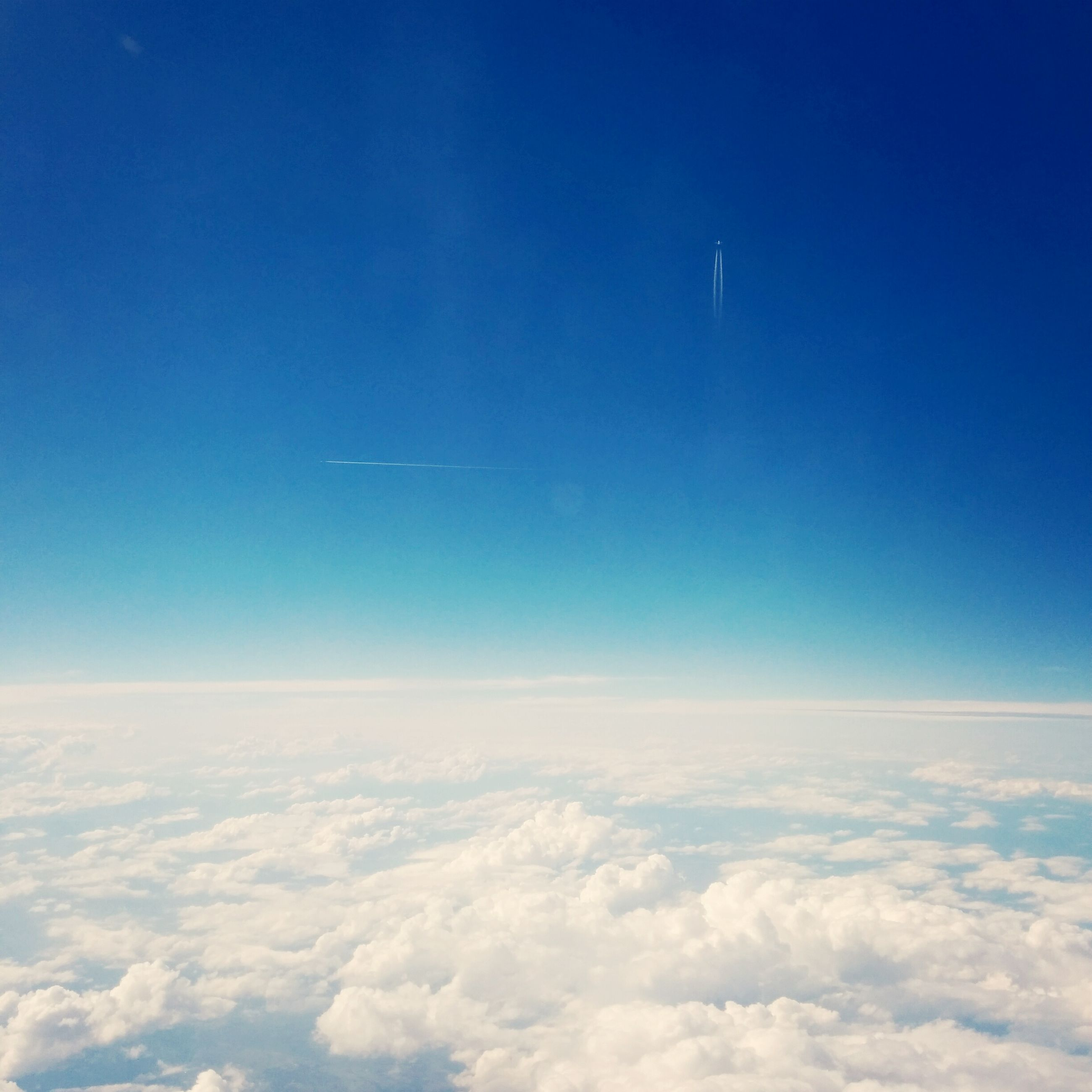 blue, scenics, beauty in nature, tranquil scene, tranquility, aerial view, sky, nature, cloudscape, idyllic, copy space, cloud - sky, sky only, airplane, flying, majestic, landscape, cloud, no people, outdoors