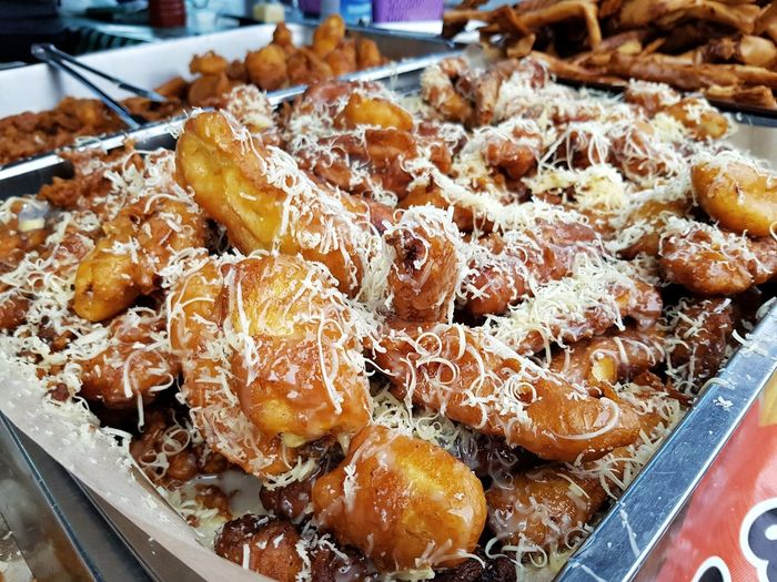 Fried Banana fritter at local market with cheese Banana Fritters Littlefoodtrail Foodphotography Food Food Photography Market Brunei Tamu Retail  High Angle View For Sale Close-up Food And Drink Stall Pastry Market Stall