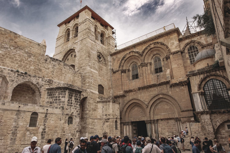 Architecture Crowd Built Structure Large Group Of People Group Of People Building Exterior History The Past Real People Men Sky Women Religion Belief Place Of Worship Tourism Arch Adult Building Outdoors Ancient Civilization Visit Israel Israelinstagram Catholicism Jesus Jesus Christ Religious  Religious Architecture Religion And Beliefs Holy Holy Land Dome Bible Old Town Middle East Faith Pray Place Of Worship