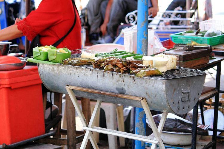 Food Cooking On Barbecue Grill At Market Stall