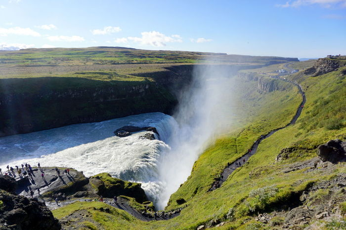 Gullfoss Waterfall Iceland Beauty In Nature Cloud - Sky Day Grass Gullfoss Gullfoss Falls Hot Spring Landscape Motion Mountain Nature No People Outdoors Physical Geography Power In Nature Scenics Sky Spray Tranquil Scene Travel Destinations Volcanic Crater Water Waterfall
