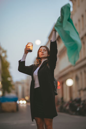 One Person Real People Holding Standing Focus On Foreground Three Quarter Length Front View Architecture Lifestyles Leisure Activity Arms Raised Young Adult Building Exterior Human Arm City Women Young Women Sky Hand Hand Raised