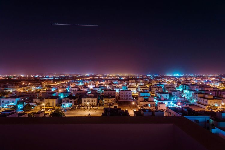 Oman Illuminated Architecture Night City Building Exterior Built Structure Cityscape Lighting Equipment High Angle View Nature Outdoors Travel Destinations Residential District City Life Crowded Light - Natural Phenomenon Building Crowd Light Sky