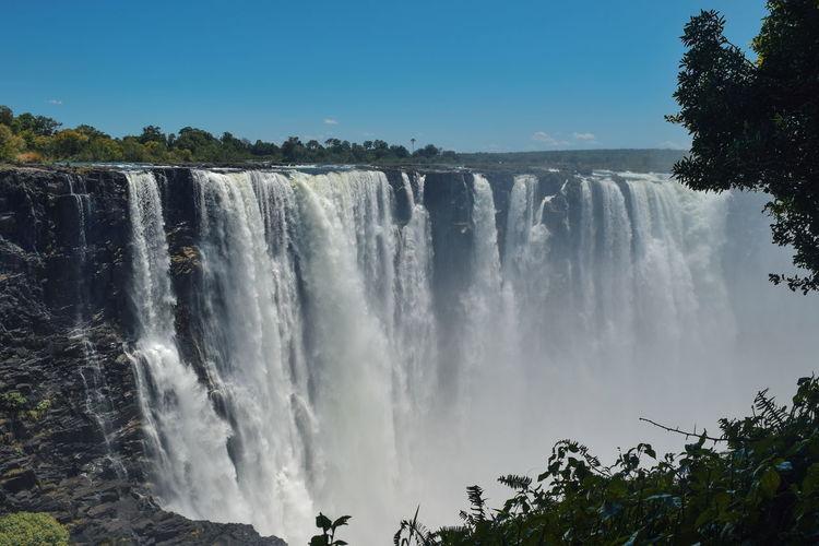 Scenic waterfall at victoria falls, zimbabwe