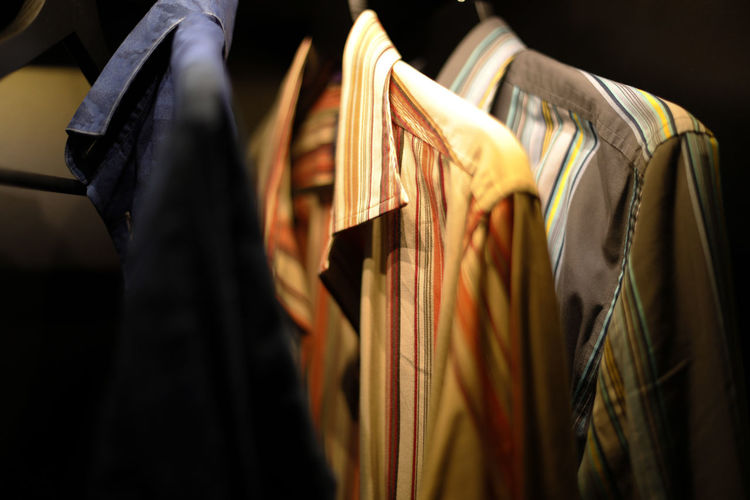 Close-up of clothes hanging on rack in store