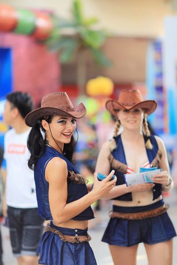 Clothing Three Quarter Length Women Lifestyles Hat Smiling Young Women Young Adult Adult Leisure Activity Real People Focus On Foreground Happiness Emotion Fashion Standing People Togetherness Day Two People