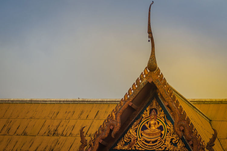Beautiful Thai's style craving and decoration on the golden gable end at Wat Sothonwararam, a famous public temple in Chachoengsao Province, Thailand. Chachoengsao Chachoengsao Province Dramatic Sundown Dramatic Sky Dramatic Sky Nature Gable End Sky And Clouds Thai's Style WAT Sothon Wara RAM Worawihan (WAT Luang PHO Sothon) Wat Sothon Wat Sothon Wararam Worawihan Architecture Belief Building Building Exterior Built Structure Clear Sky Day Dramatic Scene Dramatic Scenery Dramatic Sky At Sunset Time Dramatic Skyscape Dramatic Sunrise Dramatic Sunset Dramatic Sunset Colors Gable Gable Roof Gable Temple Naga Gold Colored Golden Gable High Section Low Angle View Nature No People Ornate Outdoors Place Of Worship Religion Roof Sky Sothon Spire  Spirituality Travel Destinations Wat Sothonwararam