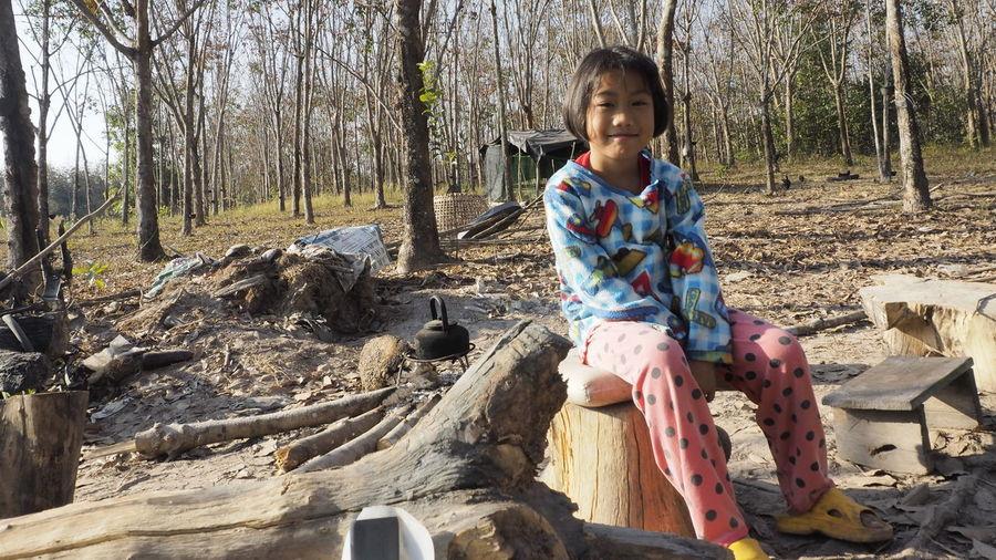 Portrait of girl sitting on land