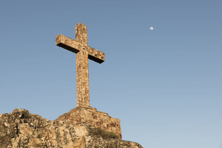 Stone cross on a hill and the moon during the sunset Ancient Believe Blue Sky Christian Christianity Clear Sky Composition Cross Hill History Low Angle View Minimal Minimalism Moon Old On The Top Outdoors Portugal Religion Simple Beauty Simple Photography Stone Material Sunset Sunset Colors Symbol