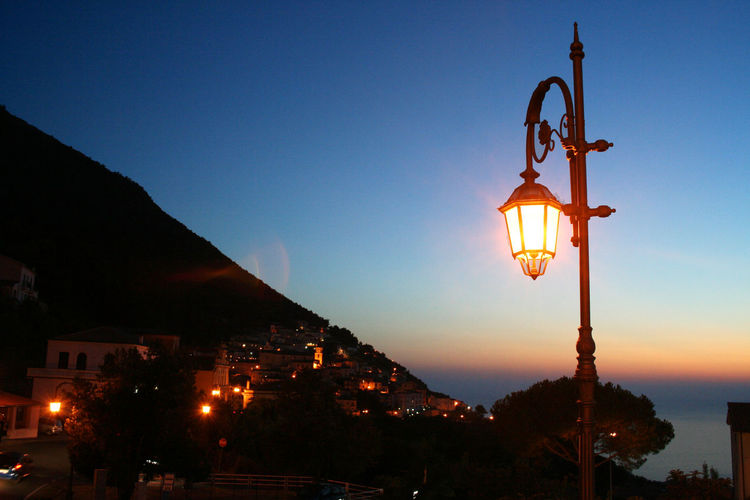 The town of Maratea at sunset Illuminated Sky Architecture Building Exterior Built Structure City No People Sunset Nature Building Outdoors Maratea Sunset Blue Hour Evening Basilicata Italy Summer Lamp Post Light And Shadow Seascape Sea High Angle View Town Village Italian