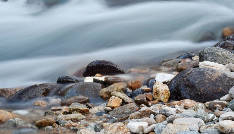Pebble Beach Motion Nature Rock - Object Beauty In Nature Wave No People Sea Outdoors Water Day Beautiful Focus On Foreground Macro Wallpaper Picoftheday Bleachmyfilm River Water Vscogood Vscocam Pebbles Peble Beach