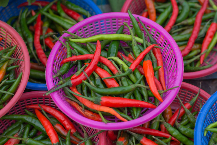 Chili peppers in baskets for sale