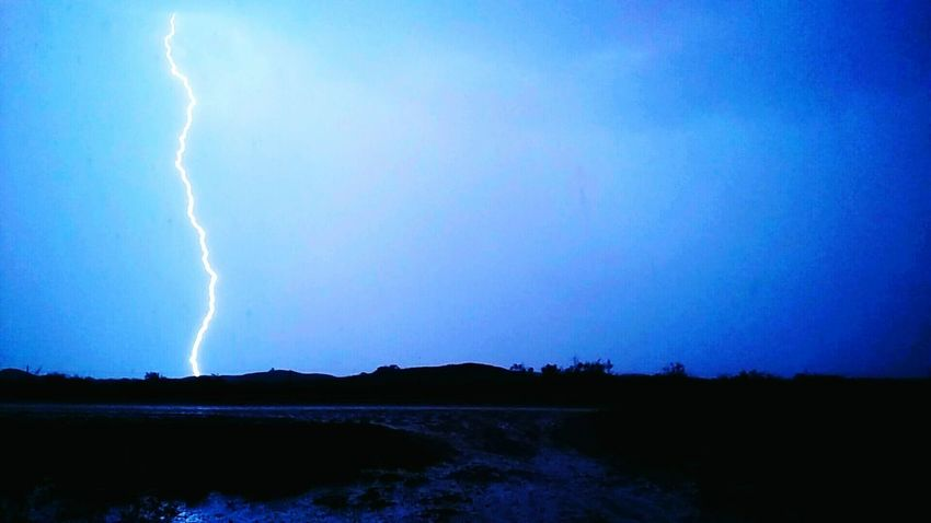 Power In Nature Scenics Blue Landscape Nature Lightning Beauty In Nature Water Storm Tranquility Environment Thunderstorm Dramatic Sky Illuminated Tranquil Scene Sky Outdoors Remote Extreme Weather Physical Geography