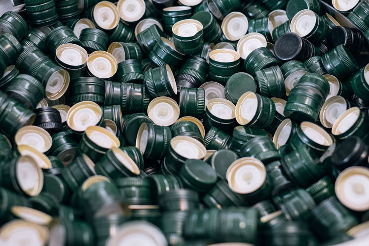 Bottle Cap Arrangement Cap Close-up Collection Design Full Frame Green Color Large Group Of Objects No People Olive Oil Screw Cap Selective Focus Shape Stack Still Life
