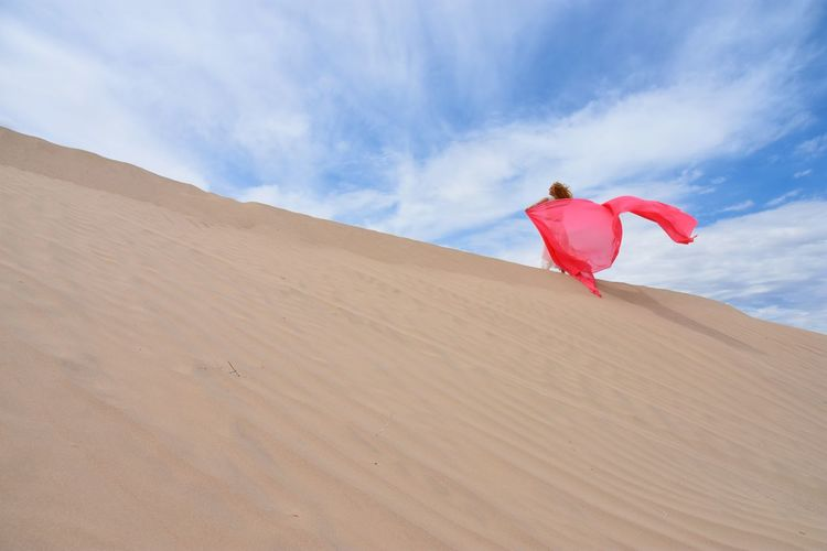 woman and pink fabric Arid Climate Beauty In Nature Cloud - Sky Day Desert Energetic Landscape Mix Yourself A Good Time Nature One Person Outdoors People Real People Sand Sand Dune Scenics Sky Tranquil Scene Tranquility