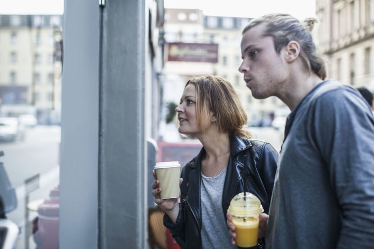 Young couple looking at drinking glass