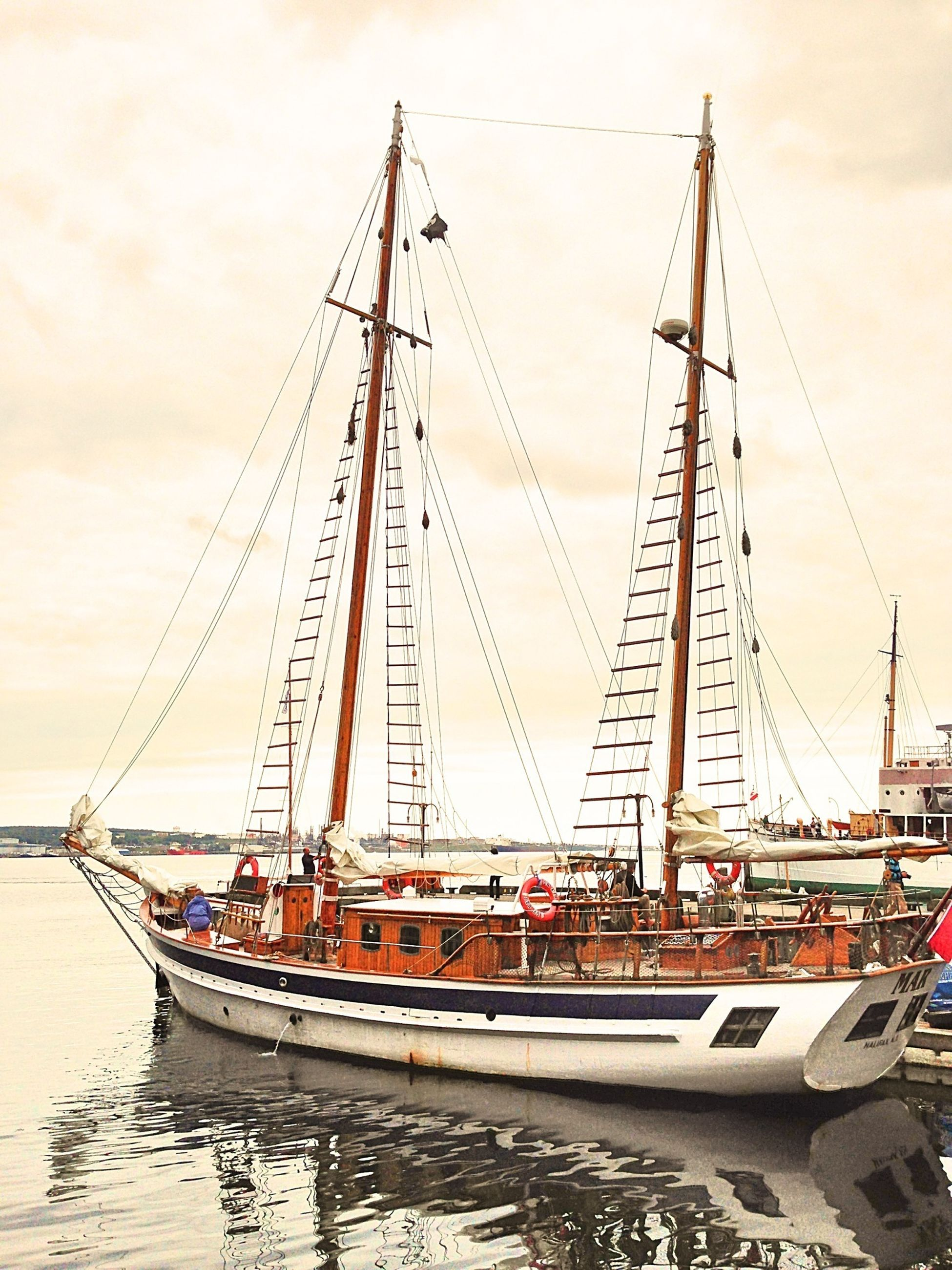 nautical vessel, transportation, mode of transport, boat, mast, water, moored, sailboat, sky, sea, travel, waterfront, sailing, harbor, cloud - sky, ship, outdoors, day, river, no people