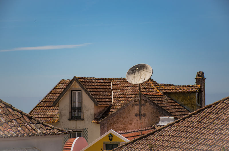 Low angle view of roof and houses against sky