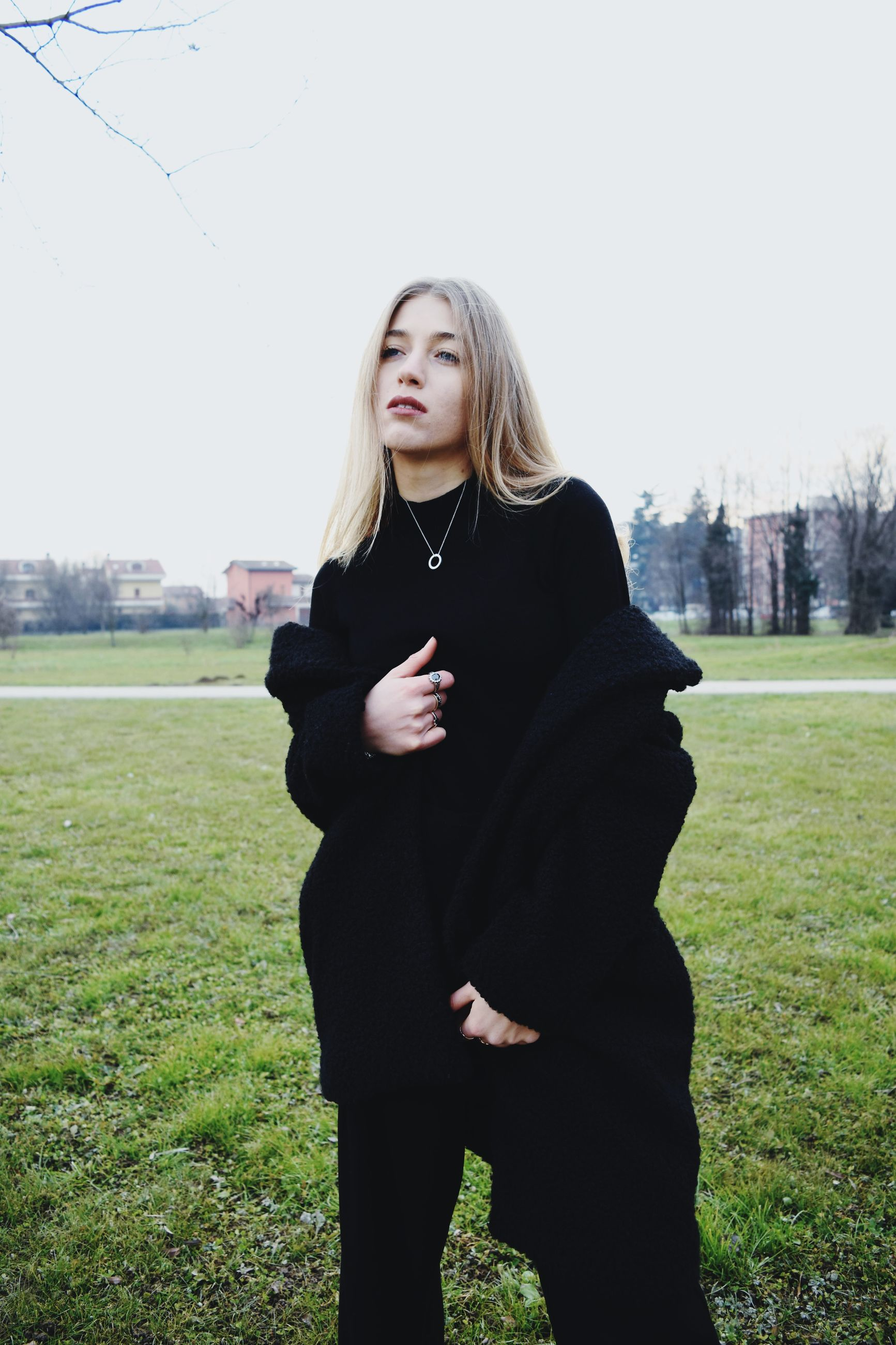 one person, three quarter length, real people, young adult, young women, standing, grass, lifestyles, plant, hair, field, blond hair, long hair, leisure activity, land, hairstyle, day, women, nature, beautiful woman, outdoors, warm clothing