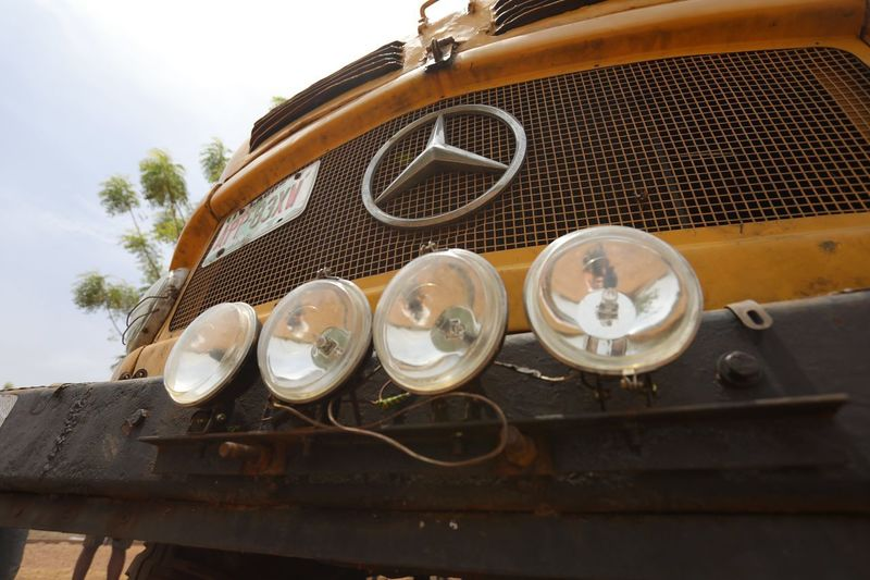 Old mercededes Bus Senegal Rugged Roadtrip Travel WestAfrica School Bus Mercedes Star Bus Lamps Old Bus Mercedes Metal Day Still Life Close-up Outdoors Land Vehicle High Angle View Sunlight Old