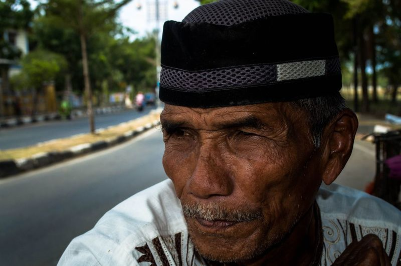 Close-up of senior man wearing taqiyah